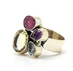 Make a more complex style statement with a multi-stone cocktail ring. #etsyjewelry