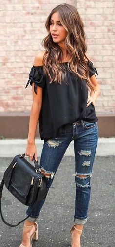 women's black off shoulder top, distressed blue jeans, and beige high heels outfit