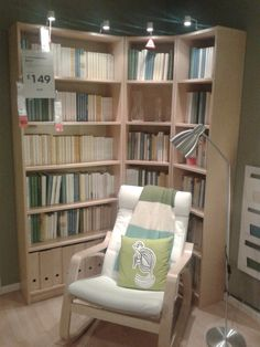 study // billy corner bookshelves and poang chair