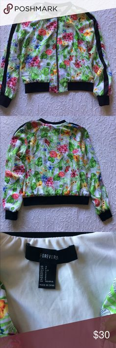 Forever 21 tropical bomber jacket Hard-to-find jacket in excellent condition!  Tropical floral print. Black trim at neck, cuffs, waist, and black satin down the sleeves. Polyester, hand wash. Forever 21 Jackets & Coats