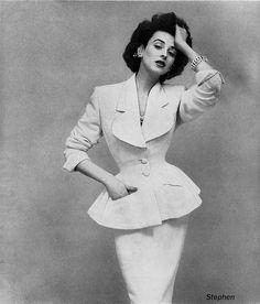 Dorian Leigh in a suit by Lilli Ann, photo by Richard Avedon for Harper's Bazaar, June 1953