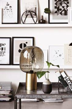 Shelves of framed graphic pics.
