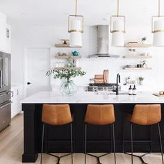 Another great kitchen by @leclairdecor. I just cant get enough of those island pendants.