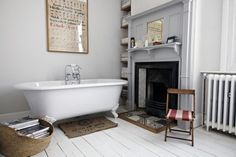 Grey bathroom with roll-top bath, white painted floorboards & original victorian fireplace. Bad Inspiration, Bathroom Inspiration, Bathroom Ideas, Simple Bathroom, Bathroom Modern, Design Bathroom, Bathroom Styling, Bathroom Interior, Grey Bathrooms