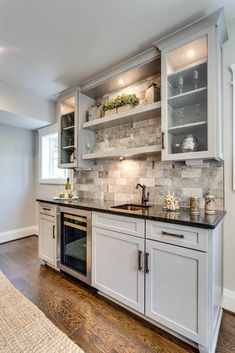 A basement is usually a room that is dark and dank. It is ignored and usually serves as a store room. Small Basement Kitchen, Kitchen Wet Bar, Basement Kitchenette, New Kitchen, Wet Bar Sink, Basement Bar Designs, Home Bar Designs, Basement Ideas, Basement Wet Bars