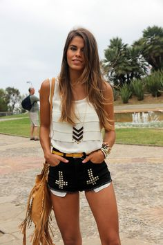 fringe purse, black shorts with diamonds on it and a white shirt. The shorts are so cool.