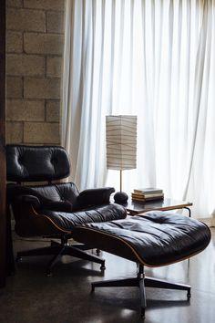 A vintage Eames Lounge Chair and Ottoman in the corner of Joan McNamara's loft bedroom. Attic Apartment, Attic Rooms, Attic Playroom, Attic Bathroom, Attic Library, Attic Closet, Attic Renovation, Attic Remodel, Leather Lounge