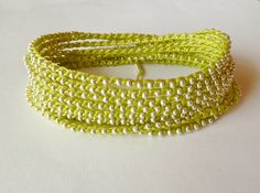 Neon Lime Green Crochet beaded bracelet, necklace, with Silver Beads, Extra Long. $29.00, via Etsy.