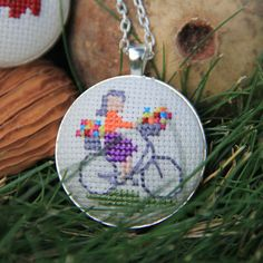 Cross Stitch Necklace Cute Girl Riding Bicycle by MotifLand