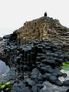 Giant's Causeway, Northern Ireland is an area of about 40,000 interlocking basalt columns, the result of an ancient volcanic eruption.