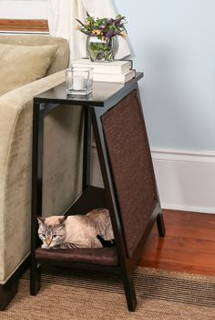 Features: -End table with sisal scratch pad and soft cushion bed. -Ventilated base provides air flow. -Plush cushion with washable cover. Product Type: -Furniture Style. Shape: -Square. Designer