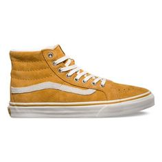 MELLOW GOLD/BEETLE  The Vans x Scotchguard™ SK8-Hi Slim is a lace-up high top with a durable Scotchguard™  treated buffed suede upper, a supportive and padded ankle, metal eyelets and Vans vulcanized signature waffle outsole.