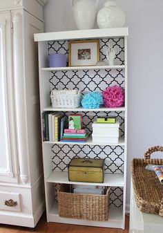Problem #1: Your walls are a shade of blah and you can't paint it since you're renting. Incorporate color or pattern by painting the back of a bookshelf or hutch—genius! 5 other ways to decorate your rental