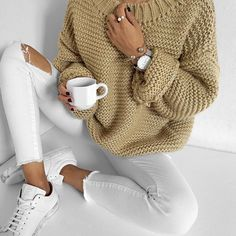 White jeans brown sweater white tennis