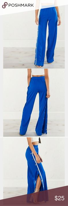 Side button jogger pant How fabulous are these? Gorgeous royal blue high waisted break away pants. Feel like you're comfy on your couch, while looking fierce and on trend. Side snaps go the full length of the pant. Please note the white stripe detail is coming up a little on one side, can be left as is or add a quick stitch. No trades, will go cheaper on merc. NWOT. Zara Pants Track Pants & Joggers