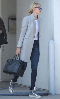 Fall style   Elegant grey coat over white top and skinny jeans, silver sneakers…