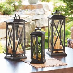 Add a decorative flair to your patio with the Better Homes and Gardens Crossbar Metal Outdoor Lantern It is made of steel with an attractive powdercoated black finish that coordinates with most lawn and garden furniture This lantern& versatile des Better Homes And Gardens, Outdoor Lighting, Outdoor Lantern, Outdoor Decor, Patio Lanterns, Small Garden Lanterns, Outdoor Ideas, Candle Lanterns, Ideas Para Decorar Jardines