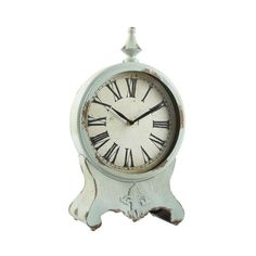 <div>This charming, pale green clock has the look of an antique! Made out of iron, it has an age...