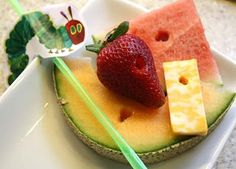 """5. #WorldEricCarle #HungryCaterpillar   Fruit and Cheese plate with foods from The Very Hungry Caterpillar book - sometimes simple is best!  Kids would love the """"worm holes""""!"""