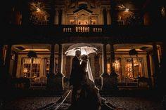 Rain on your wedding day = fabulous umbrella portraits   Photo by Neil Redfern