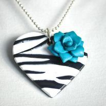 PENDANT:  ∞ Handmade out of polymer clay  ∞ Approx. meas. 2.25 inch.  ∞ Hangs on a 90 cm length of ball chain  ∞ Can easily be shortened yourself  RING:  ∞ Handmade out of polymer clay  ∞ Approx. meas 1.75 inch.  ∞ Adjustable ring  EARRINGS: ∞ Handmade out of polymer clay  ∞ Approx. ...