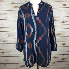 """[Amanda Uprichard] Silk Aztec Tribal Tunic Medium Gorgeous silk tunic blouse. All over tribal/Aztec graphic. V neck. 3/4 Sleeves. A unique piece for fall.  Color: Blue, Red, Brown. Fabric: Silk Size: Medium Bust: 18"""" Length: 28"""" in front 30"""" in back. Condition: EUC. No flaws.  No Trades! No PayPal! Amanda Uprichard Tops Tunics"""