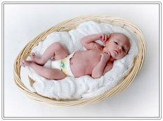 Google Image Result for http://www.babyphotospictures.com/thumb/newborn-baby-enjoying-a-basket-bed.jpg