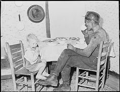 Rufus Sergent, miner, and his son have a bit to eat after work. P V & K Coal Company, Clover Gap Mine, Lejunior, Harlan County, Kentucky., 09/15/1946. National Archives.