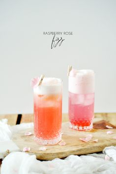Raspberry Rose Fizz Cocktail | It's pink and pretty and fizzy and RIDICULOUSLY delicious. I'm fairly certain that you need to whip up a batch (or two) immediately, if not sooner. @jacquelynclark
