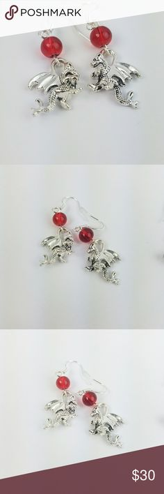 Ember Tiny Dragon Earrings Clear Red Czech glass beads with silver plated tiny dragon charms on .925 Sterling Silver hooks.   Lool for a matching pixie bottle necklace or single bracelet here in my closet.  Magen's Fairytale Creations original handmade by me. Magen's Fairytale Creations Jewelry Earrings