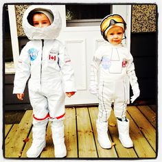 Homemade Astronaut costumes for Halloween. I made the one on the left from a pilot costume, old winter boots, and rolls and rolls of white duct tape from the Dollar Store. The helmet is paper mache. Costume on the right was adapted from a bargain bin Star Wars costume.