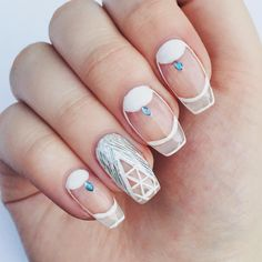 Holographic Silver and White Negative Space Nails With Blue Rhinestones