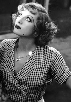 Joan Crawford as Sadie Thompson, photographed by John Miehle during the filming of a scene from Rain (1932)