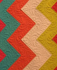 Gorgeous Quilting! I love that each zig zag the feathers go a different way..