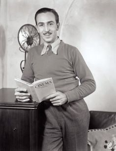 Walt Disney and a book.