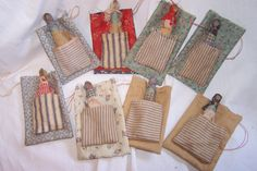 PRIMITIVE POCKET DOLLS These charming clothespin pocket dolls are reminiscent of play things for children in days gone by. Dressed in homespun, these dolls are happily tucked in their ticking pocket on a muslin or homespun drawstring bag. PRICE EACH $11.00 + SHIPPING (FABRIC PRINTS WILL VARY)