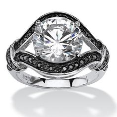This dazzling round cubic zirconia ring is elegantly wrapped by contrasting round black cubic zirconia accents