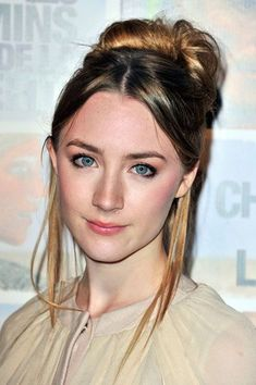 Saoirse's high bun with a center part and bangs tucked behind.                                           http://www.nme.com/news/the-lovely-bones-star-saoirse-ronan-signs-up-for-877731