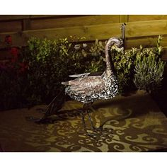 Smart Solar Metal Silhouette Peacock. The Smart Solar Metal Silhouette Peacock looks great night or day. In the day they look great in any garden and will be charged up in sunlight thanks to the integral solar panel, then at night the lights automatically come on. Fully charged it can light up to about 6 hours. The peacock has a white and a colour changing LED inside. £29.99
