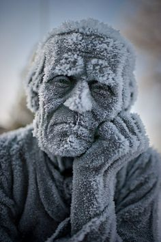 Looks real but is a photo of a frozen statue by photographer Miika Järvinen.