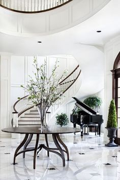 Black, white and green.  Sweeping staircase and grand piano in the entrance hall via WINTERBERRY