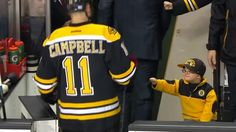 Watch adorable Boston Bruins fan fist-bump the entire hockey team
