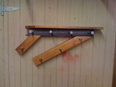 asymmetrical wall mounted coat rack made from reclaimed wood, reclaimed I beam and bolts