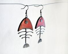 Fish bone earrings made of red stained glass, patinated copper and tin without lead. Unique statement jewelry! If water gets on the jewelry, wipe the metal with a dry cloth right away. Copper patina is steadfast and will not transfer to skin when handled. Big but not too heavy. Length is 6 cm ( 2, 1/3) with ear hooks. If you need fish necklace please look here: https://www.etsy.com/listing/262482617/fish-bone-necklace-white-fish-skeleton