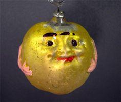 Antique Hand Blown Apple Face Ornament.