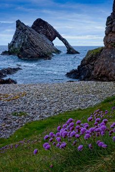 Bow Fiddle Rock, Portknockie, Scotland.  Portknockie is a coastal village on the Moray Firth in northeast Scotland, in Moray. Nearby towns include Banff, Buckie, Findochty and Cullen. Wikipedia