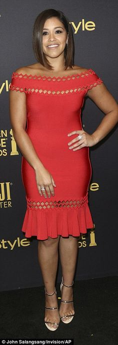 Gina Rodriguez stood out in a red bandage dress...