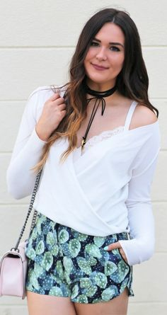 How cute are these cactus shorts?! | | Fashion blogger Mash Elle shares a casual spring/summer outfit with an Urban Outfitters white top, Vanessa Mooney black choker, Topshop Cacus print shorts, white lace bodysuit from Kohl's and a Rebecca Minkoff pink blush Love Crossbody.