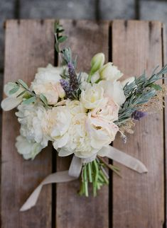 lush white bouquet with peonies, lavender, rosemary and olive leaves