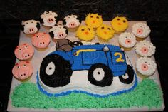 This is the tractor cake and farm animal cupcakes I made for my son's 2nd birthday.  The cupcakes were a huge hit and my son loved his tractor birthday cake!